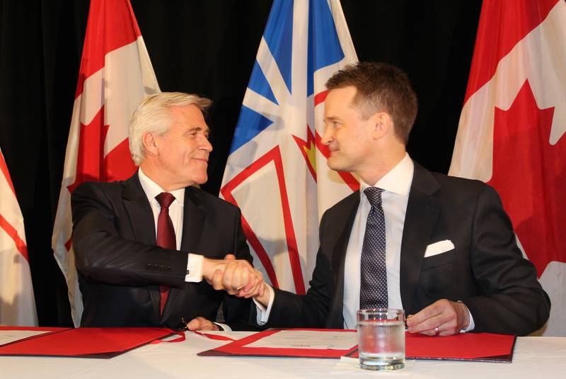 Premier Dwight Ball and federal cabinet minister Seamus O'Regan shake hands