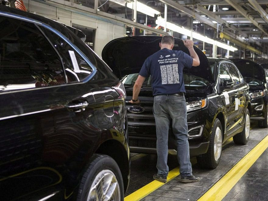 Ford Edges sit on a production line as Ford Motor Company celebrates the global production