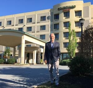 Russ Urban, president of High Hotels Ltd., stands at the Courtyard by Marriott in Lancaster, Pa