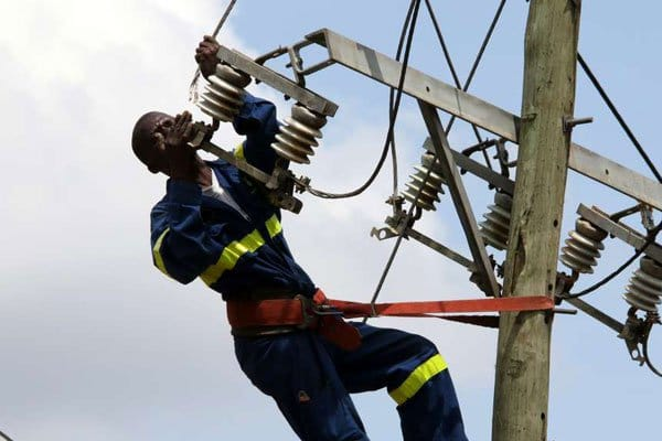 A Kenyan powerline worker repairs an electricity line