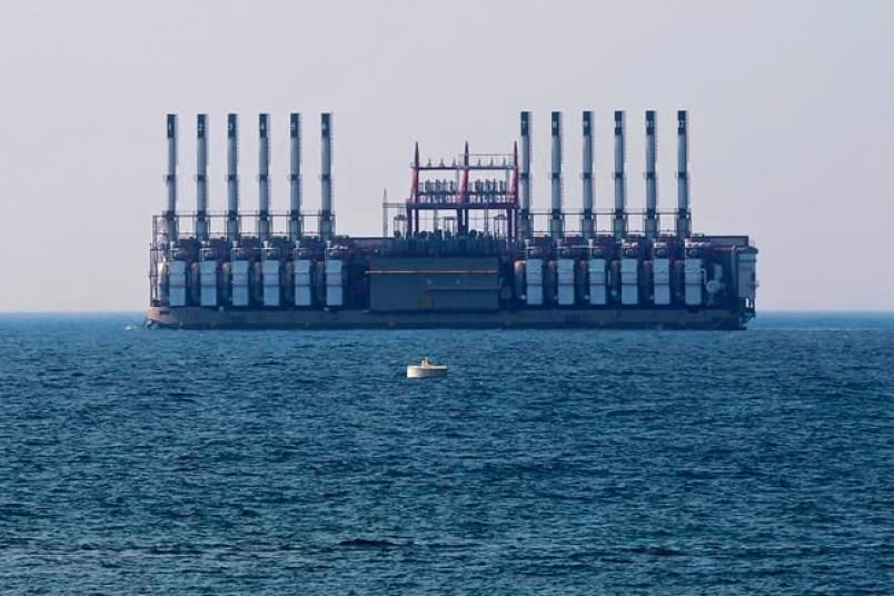 In this July 16, 2018 photo, a floating power station waits off the coast at Jiyeh, south of Beirut, Lebanon.
