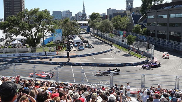 Drivers pass through the first turn at the Montreal Formula ePrix electric car race