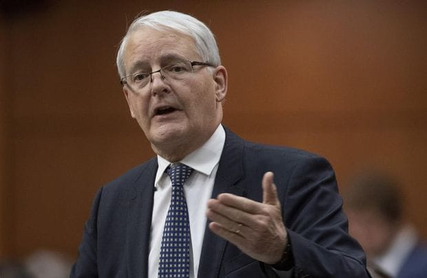 Transport Minister Marc Garneau is considering expanding the government's $300-million rebate program for people who buy electric vehicles after half the funds were claimed in just eight months