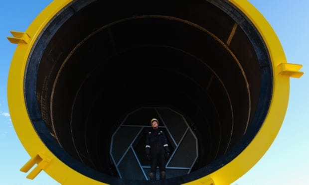 An engineer stands inside a transition piece that will connect the foundation to the tower at Hornsea One offshore windfarm.